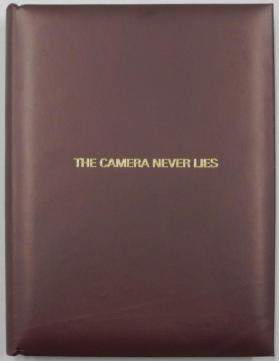 The Camera Never Lies:  a book of 26 pages, boxed.