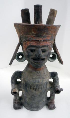 Seated figure in the form of bottomless cylindrical vessel that was placed over burning incense
