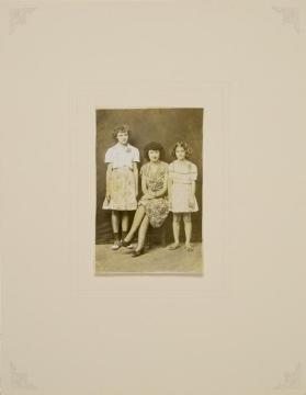 Untitled (Two Girls Standing Next to Seated Woman)