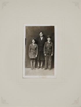 Untitled (Girl and Boy in Scouts Uniforms Flanking Woman in Dark Suit)