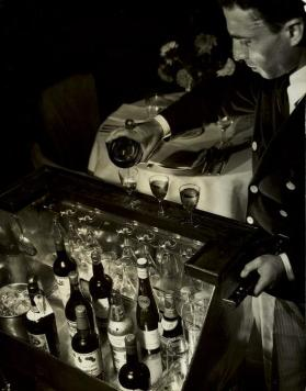 Man Pouring Drink at Bar