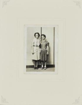 Untitled (Two standing women in ruffled dresses)