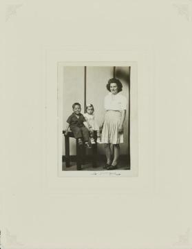 Untitled (Standing mother with two seated children)