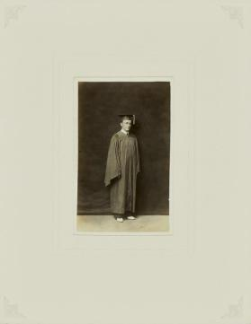 Untitled (Standing graduate in cap and gown)