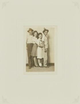 Untitled (Four young people standing, striped background)