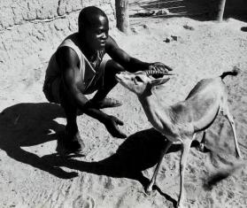 In the zoo Jos in Northern Nigeria a trainer shows off one of the animals, Nigeria