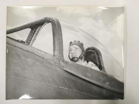 Pilot seated in plane