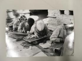 Children writing on chalkboards, India