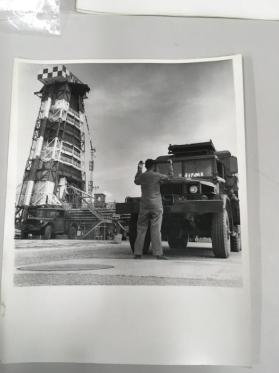 Cape Canaveral Space Center, Florida – military technicians with truck in front of  rocket launching tower