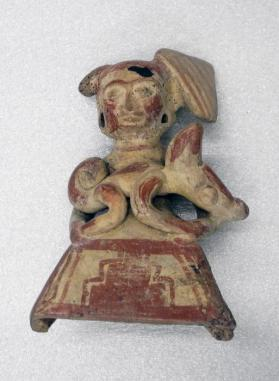 Woman Holding a Pisote Figurine
